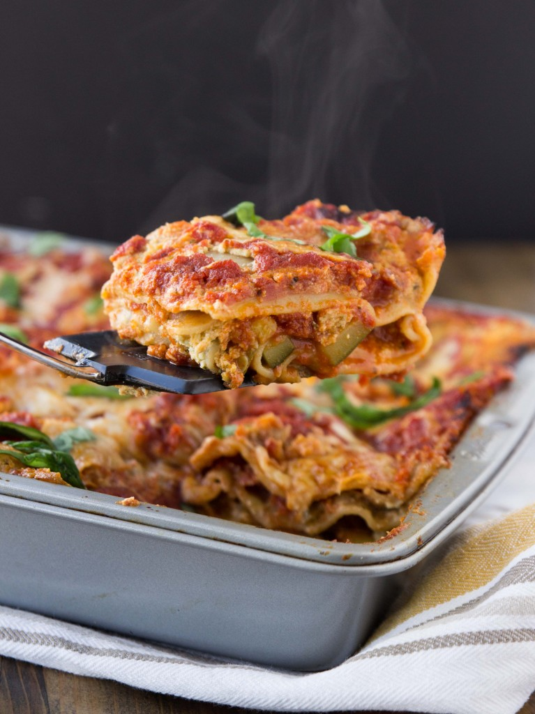 A vegetarian lasagna bursting with flavor from summer squash, basil pesto ricotta, and a homemade tomato sauce | http://veggieandthebeastfeast.com