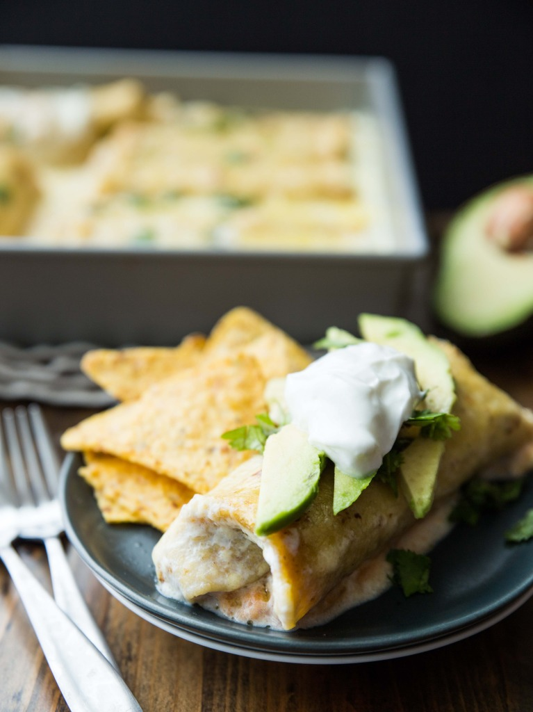 High Protein Sweet Potato, Pinto and Black Bean Enchiladas with White Cheddar Sauce // veggieandthebeastfeast.com