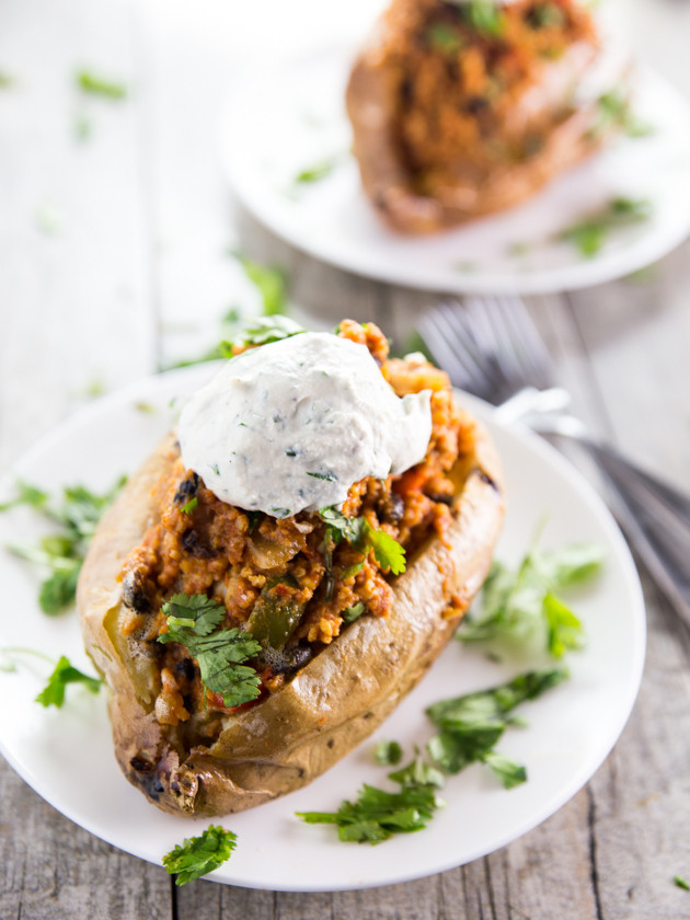 Enchilada Millet Stuffed Sweet Potatoes with Cilantro Garlic Cashew Cream