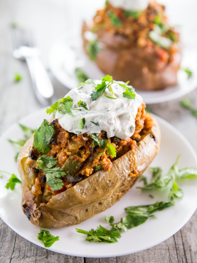 Black Bean Enchilada Millet Stuffed Sweet Potatoes with Cilantro Garlic Cashew Cream