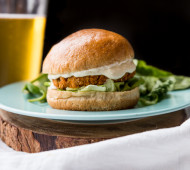 Buffalo Chickpea Sweet Potato Burgers with Whipped Feta Garlic Sauce // @veggiebeastblog