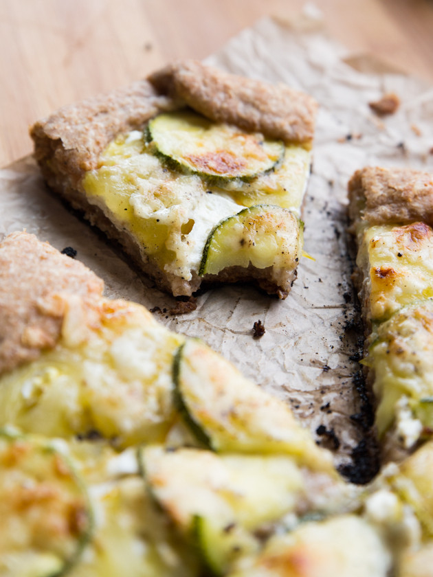 Zucchini and Heirloom Tomato Galette with Garlic Yogurt Sauce - summer veggies on top of creamy yogurt sauce, wrapped in a buttery whole wheat crust!