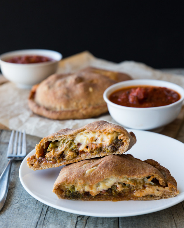 Roasted Broccoli and Smoked Gouda Calzones - homemade whole wheat beer crust, my favorite pizza sauce, and melty cheese! Comfort food at its finest.