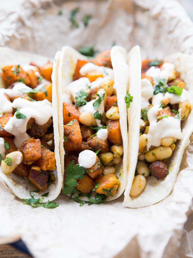 Curried Butternut and White Bean Tacos - lightly sweet, spicy, butternut squash with lemon parsley white beans and a smooth cashew cream #vegan #glutenfree