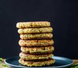 Easy vegan and gluten free falafel patties that are lightly pan-friend to golden brown, and drizzled with a quick tahini dill dressing.